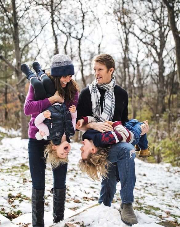David and Daniela enjoy a walk with their kids in the snow