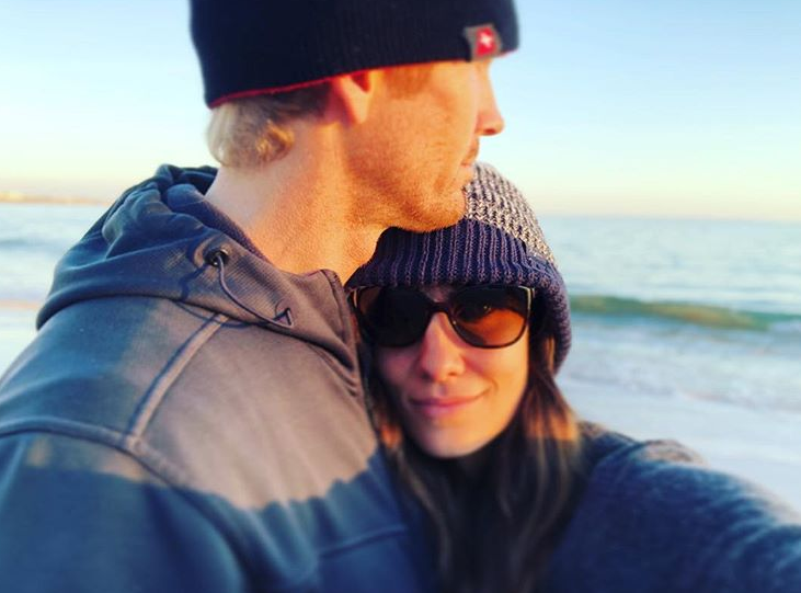 Daniela shares a snap of herself with her husband, looking out to the sea