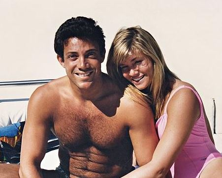 Jordan and Nadine sunbathe at a beach
