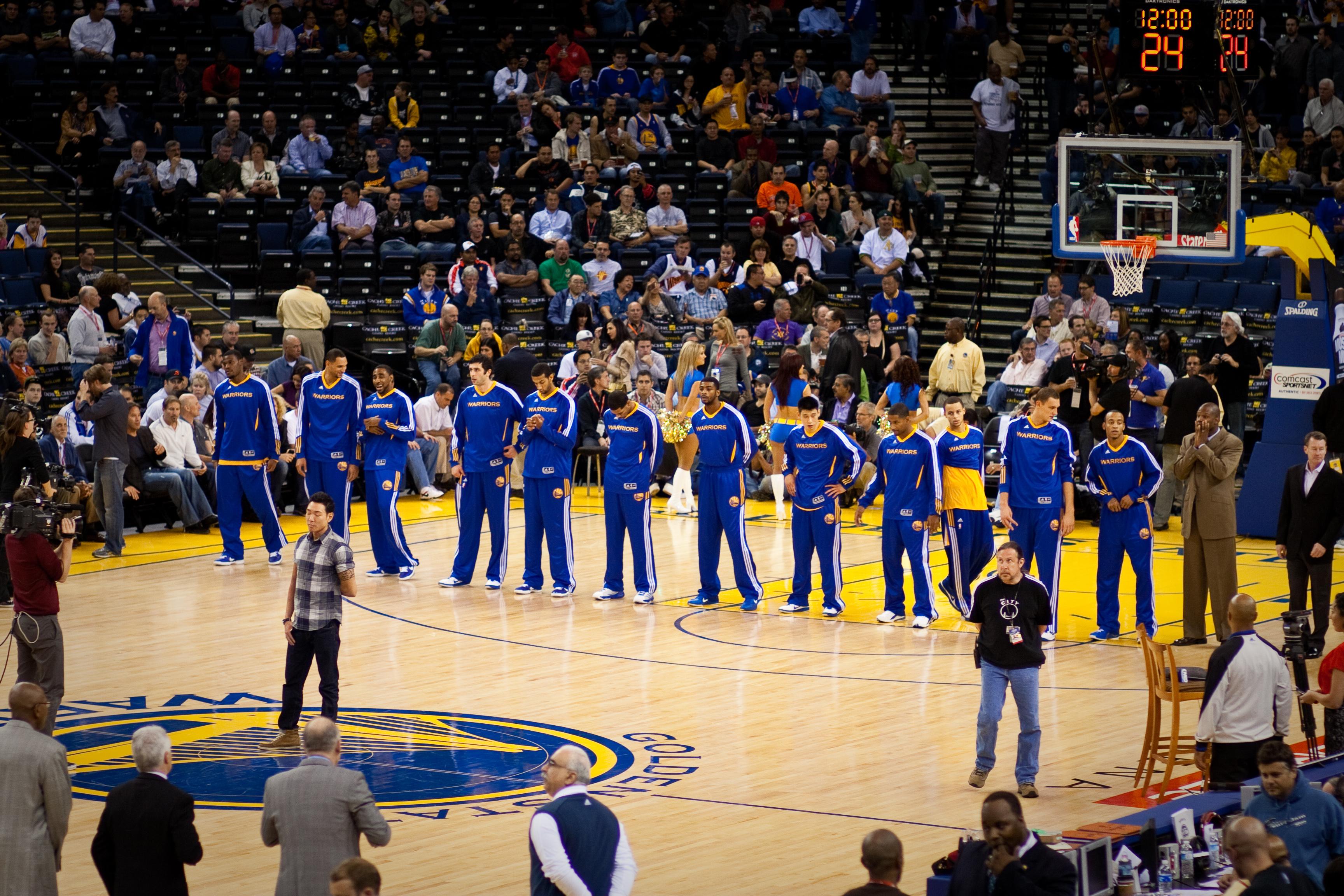 Golden State Warriors Line Up: From Left: Jeff Adrien, Dan Gadzuric, Reggie Williams, Vladimir Radmanović, Brandan Wright, Rodney Carney, Dorrell Wright, Jeremy Lin, Charlie Bell, Stephen Curry, Andris Biedriņš, and Monta Ellis