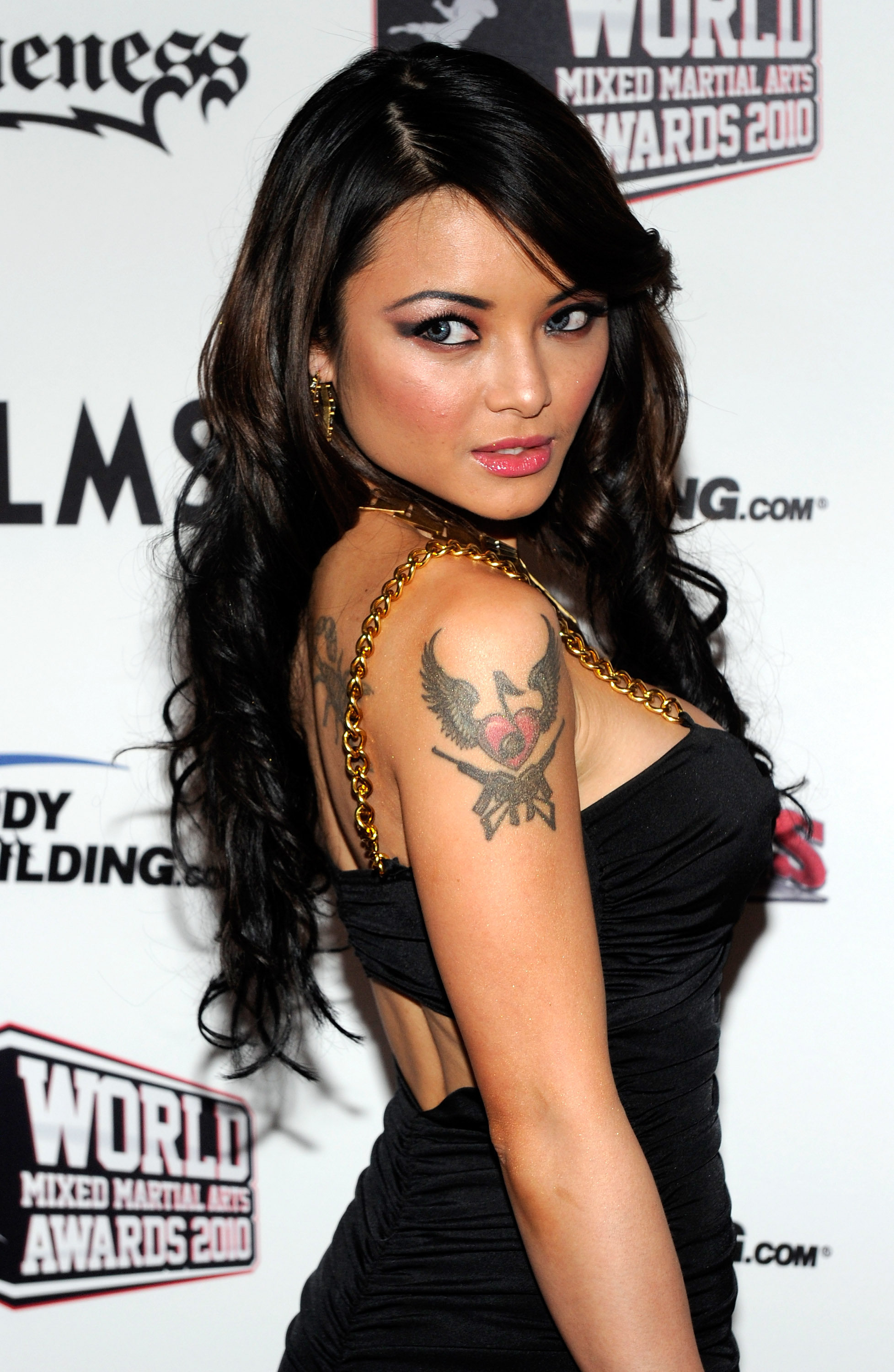 Tila Tequila giving a bold and hot look in a black dress