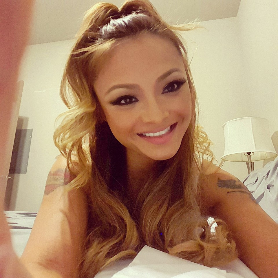 Tila Tequila on a bed