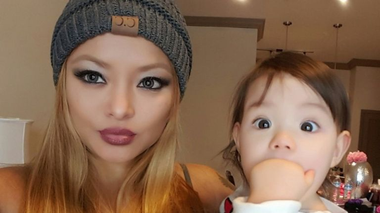 Tila tequila clicking selfie with one of her daughter
