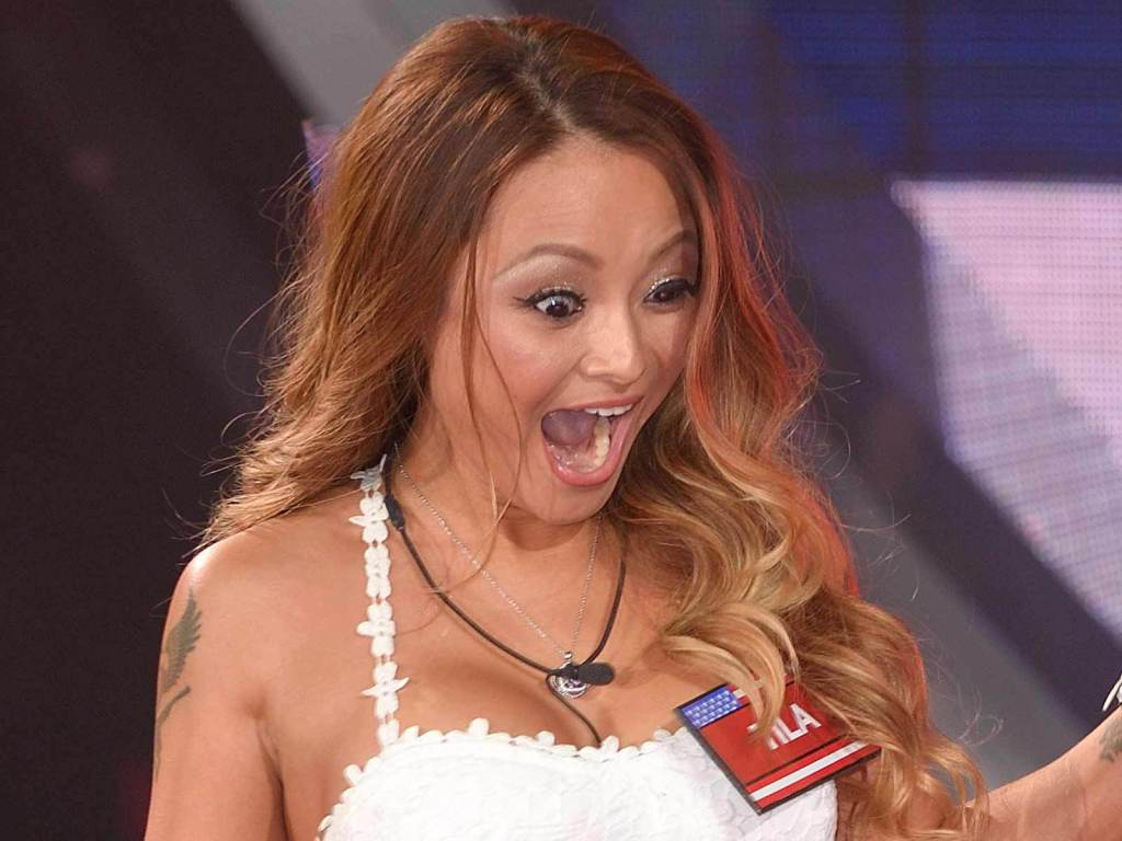 Tila Tequila screaming in a show in her white dress