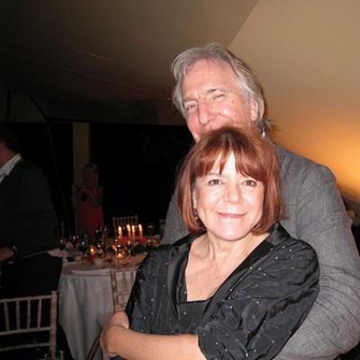Rima Horton being hugged by Alan Rickman