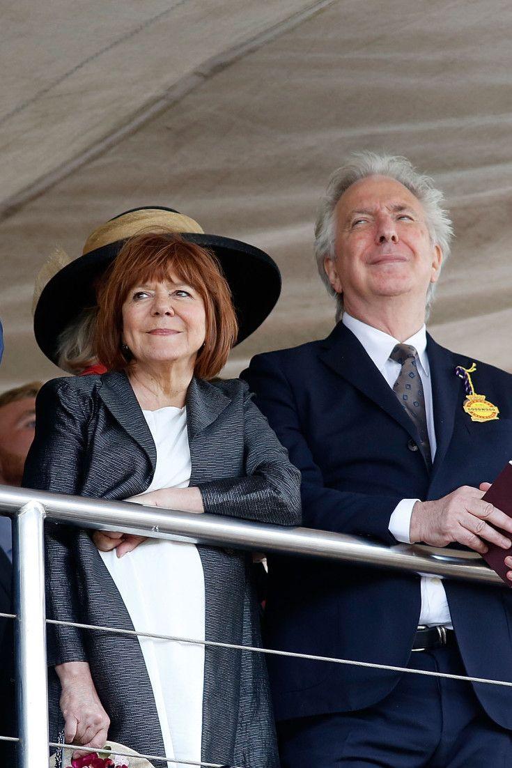 Alan Rickman and Rima Horton observing an event