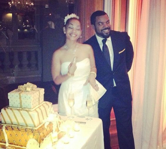 Ice Cube and her wife during their marriage. Their is cake in the background.