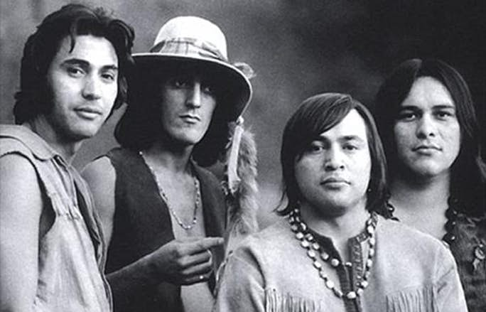 B&W picture of 70s band Redbone. There are four members of the band in the picture