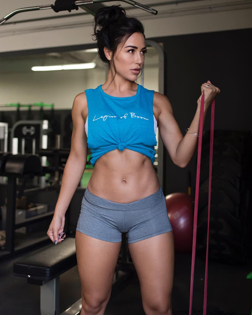 Ana Cheri in the gym showing off her hot body holding an equipment