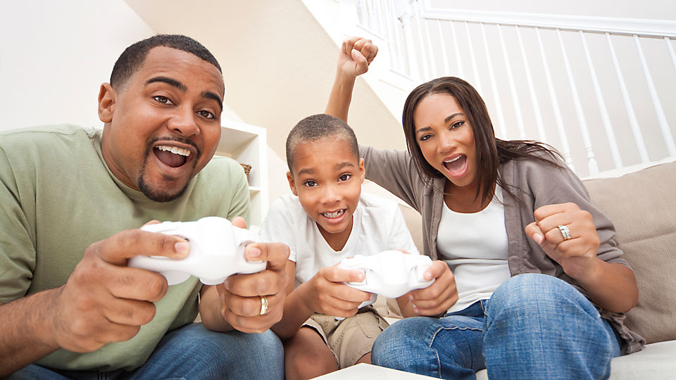 A family playing video game with controllers.
