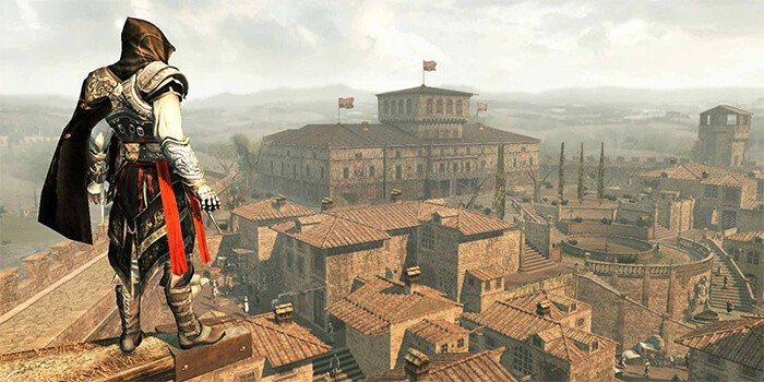 A video game character looks over a medieval city.