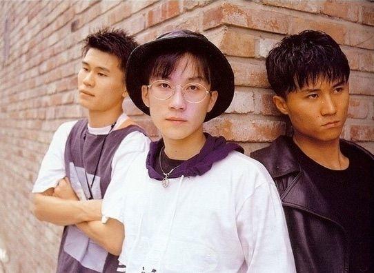 Seo Taiji and Boys members Seo Taiji, Yang Hyun-Suk and Juno pose for a picture against a wall.