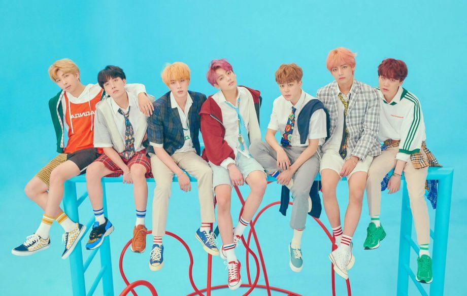 BTS members V, J-Hope, RM, Jin, Jimin, Jungkook, and Suga pose for a photo.