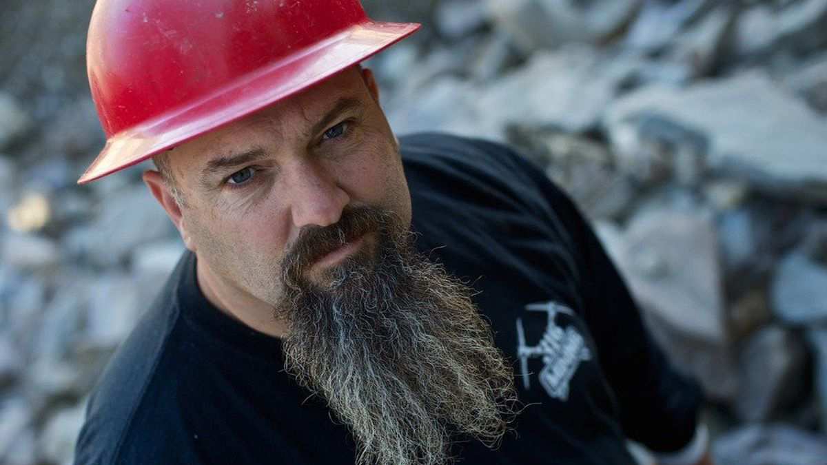 Todd Hoffman looks up to a camera in a mining site.
