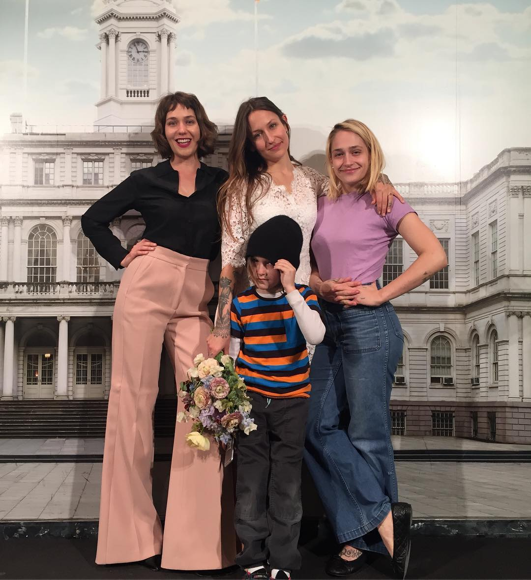 Domino Kirke on her wedding day with sisters Lola Kirke and Jemima Kirke and her son Cassius.