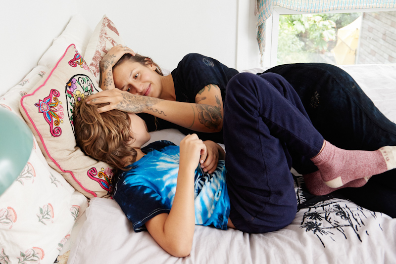 Domino Kirke and son Cassius pose for a picture while sleeping in bed.
