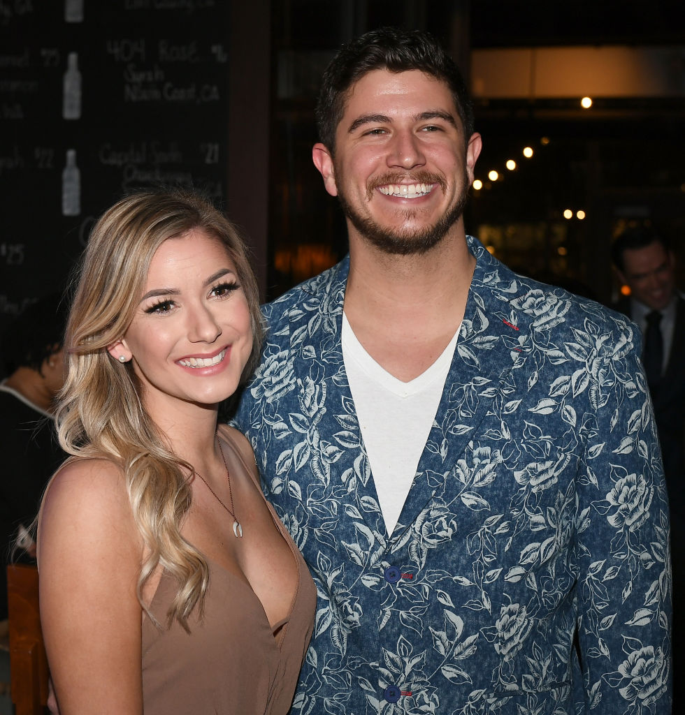 Amber Pike and Matthew Barnett smile as they pose for a picture during a Love is Blind event.