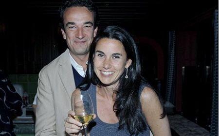 Olivier Sarkozy and his ex-wife Charlotte Bernard pose for a picture.