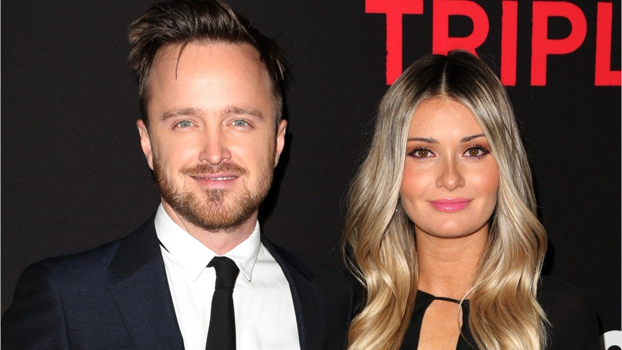 Aaron Paul and wife Lauren Parsekian pose for a picture during an event.