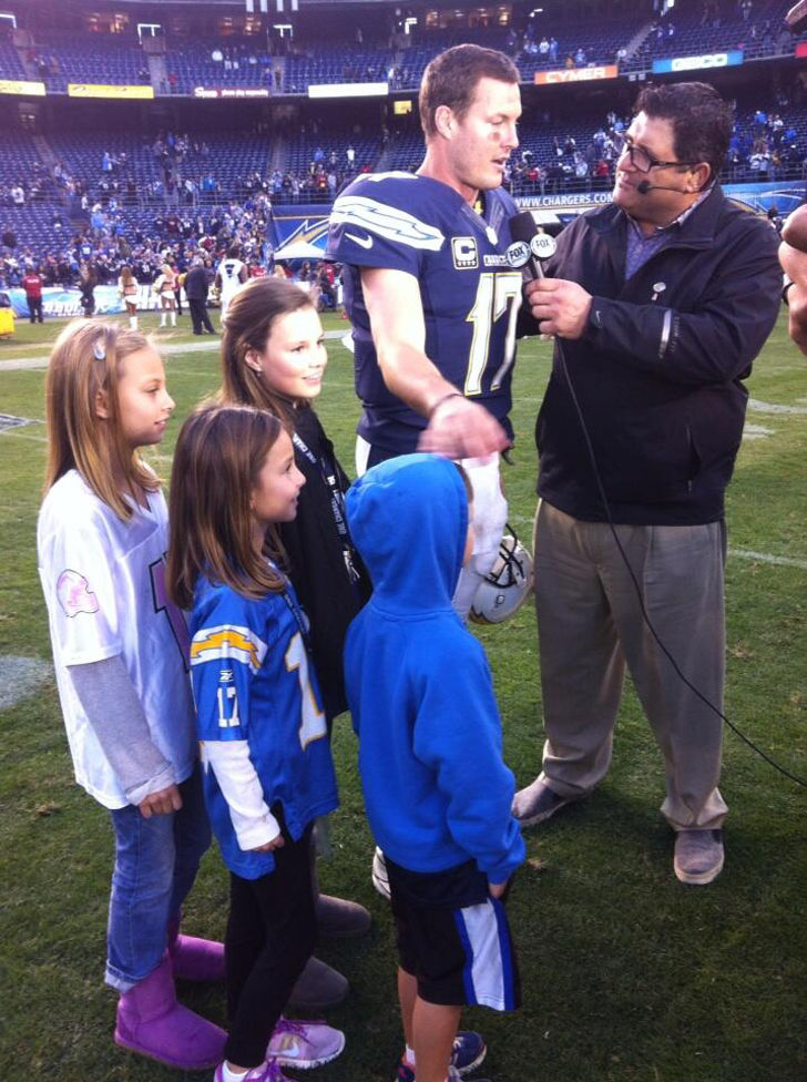 Philip Rivers with his son and three daughters in one of his matches