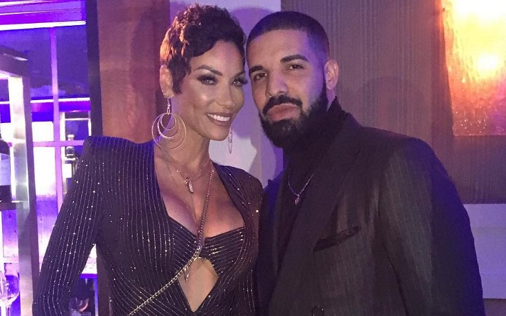 Drake seen again with Nicole Murphy at Her 50th Birthday Party